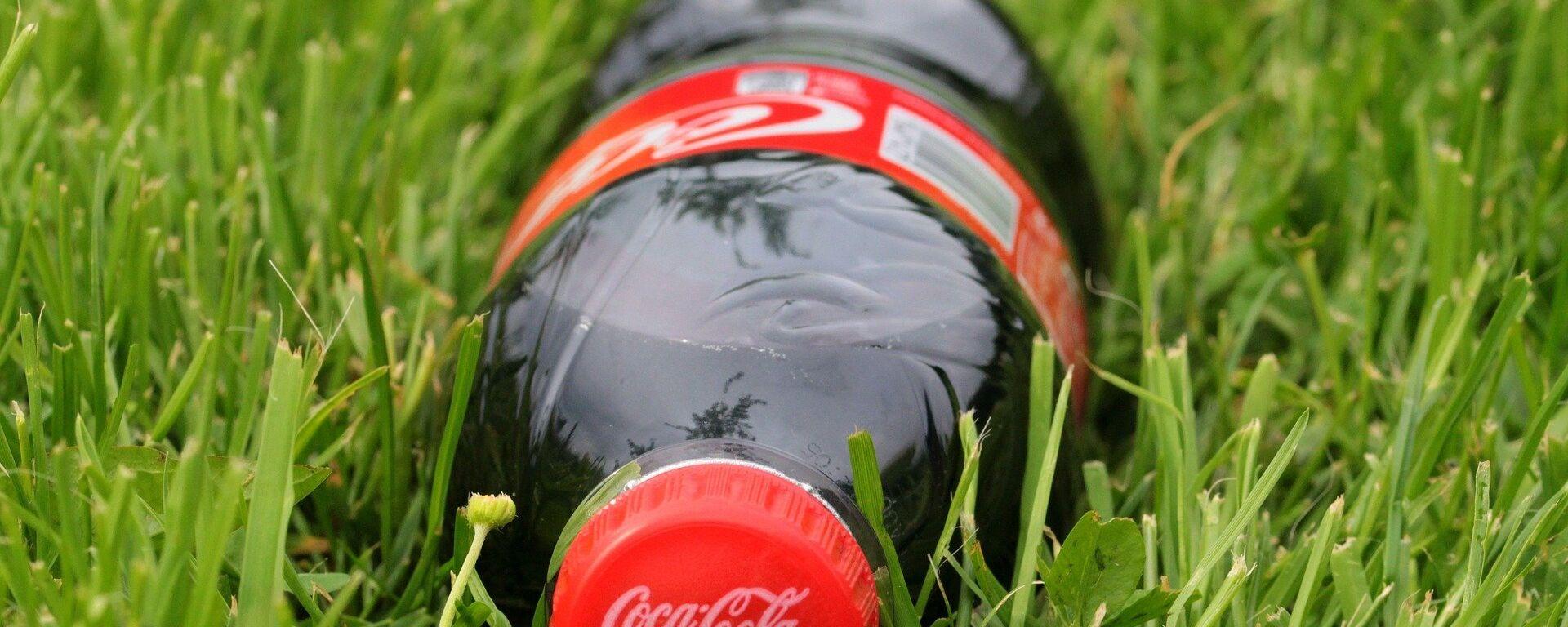 Una botela de Coca-Cola - Sputnik Mundo, 1920, 18.06.2021