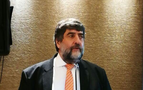 Ricardo Martínez,  gerente regional de SearchInform y jefe de la representación en Argentina, en la conferencia en Buenos Aires. - Sputnik Mundo