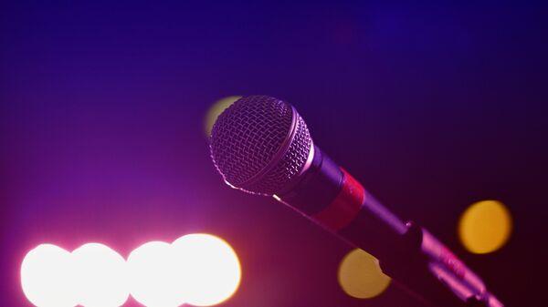 Un micrófono, imagen referencial - Sputnik Mundo