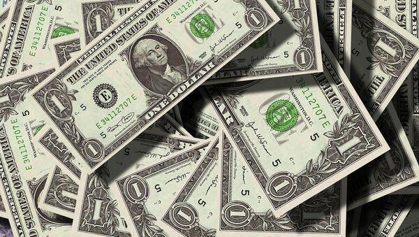 Dólares (imagen referencial) - Sputnik Mundo
