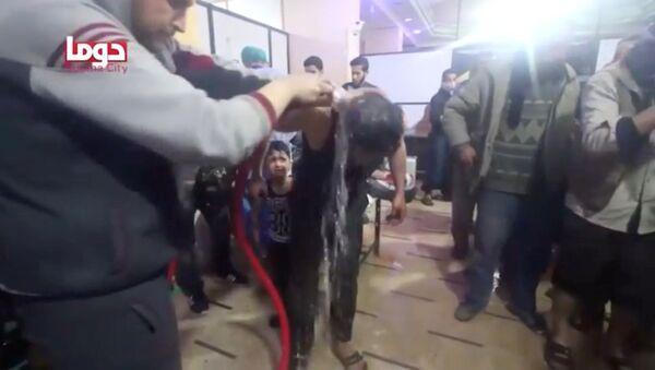 Captura de pantalla del vídeo del supuesto ataque químico en Duma, Siria - Sputnik Mundo