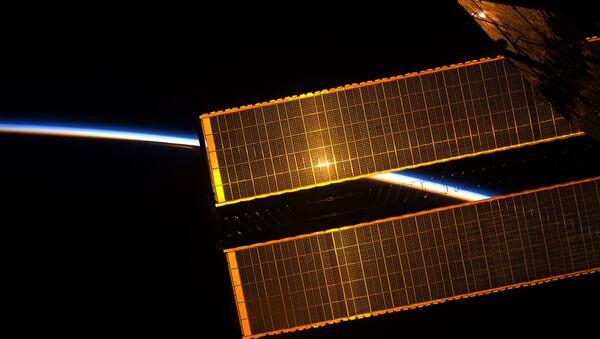 La vista desde la EEI, el amanecer - Sputnik Mundo