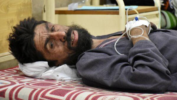Uno de los sobrevivientes, en un hospital local - Sputnik Mundo