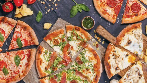 Pizza en el restaurante Donna Olivia - Sputnik Mundo