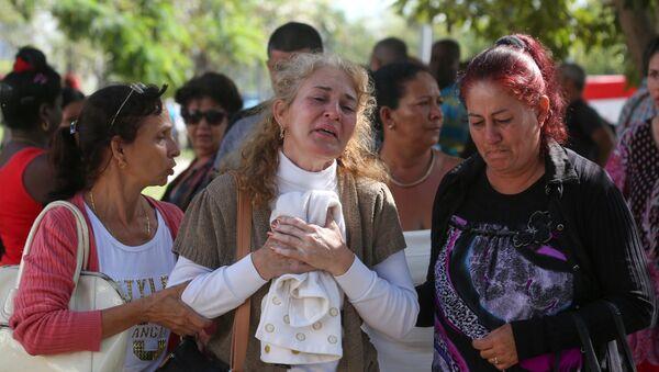 Familiares de las víctimas del estrello del avión Boeing 737 en Cuba - Sputnik Mundo