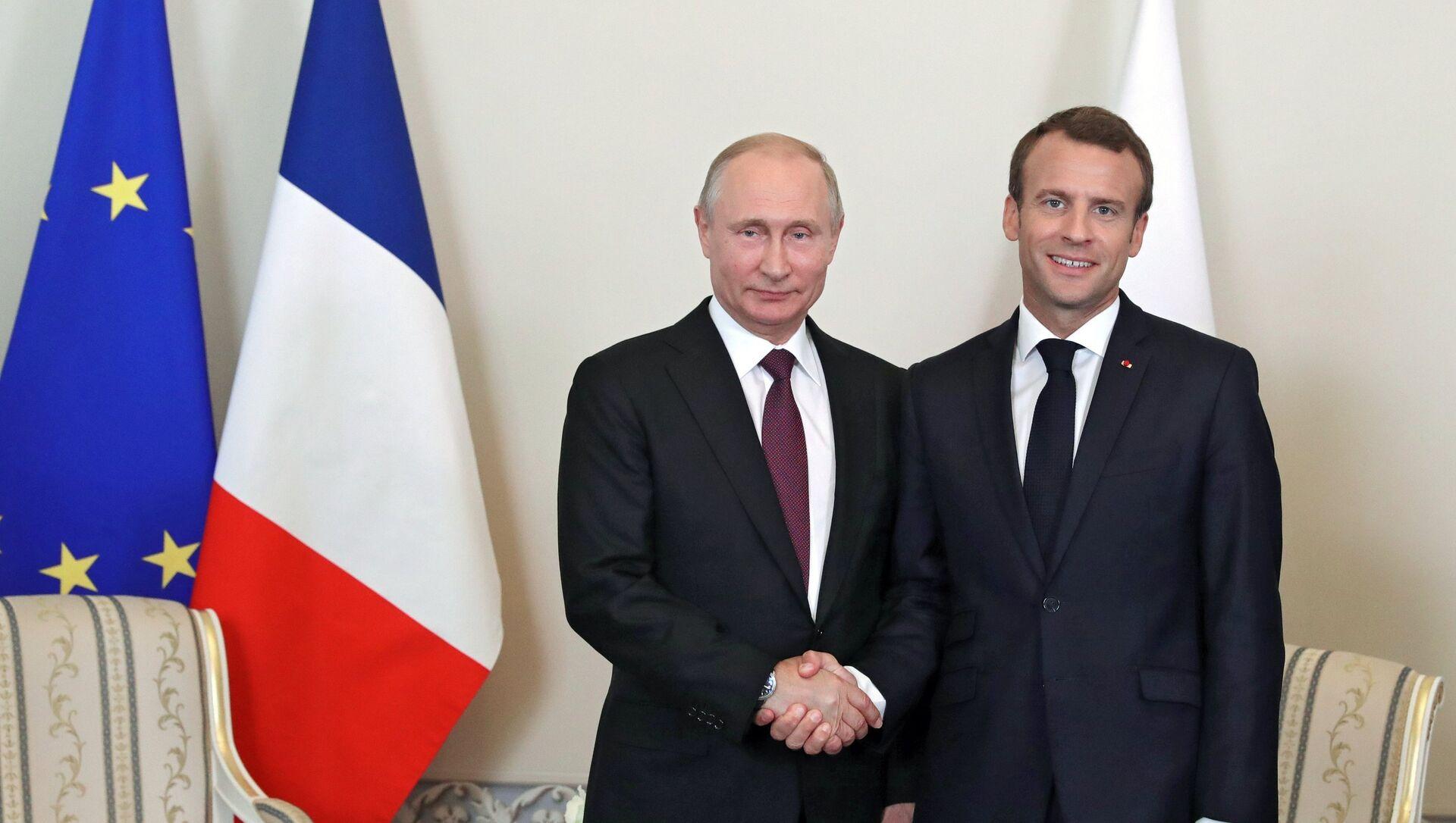 Vladímir Putin, presidente de Rusia, y Emmanuel Macron, presidente de Francia - Sputnik Mundo, 1920, 10.02.2021