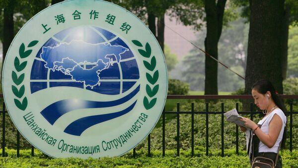 El logo de la Organización de Cooperación de Shanghái (OCS) - Sputnik Mundo