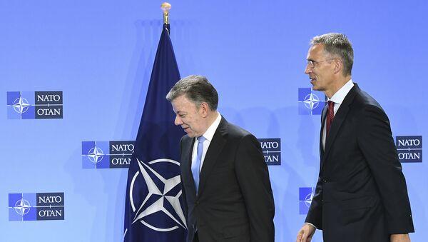 Juan Manuel Santos, presidente de Colombia, y Jens Stoltenberg, secretario general de la OTAN - Sputnik Mundo