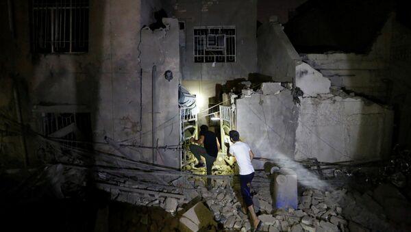 Lugar del explosión en el barrio Madinat al Sadr al este de Bagdad - Sputnik Mundo