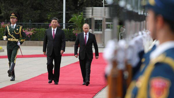 Presidente de China, Xi Jinping, y presidente de Rusia, Vladímir Putin - Sputnik Mundo