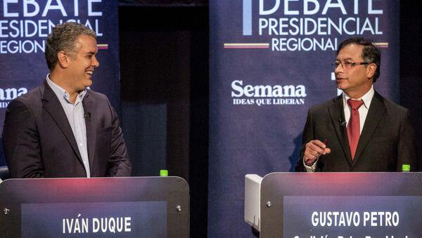 Gustavo Petro junto a Iván Duque, candidatos a la presidencia de Colombia - Sputnik Mundo