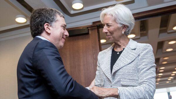 El ministro de Hacienda de Argentina, Nicolás Dujovne, y la directora del FMI, Christine Lagarde - Sputnik Mundo