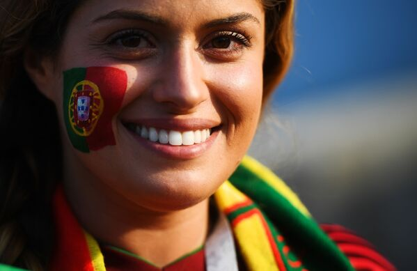 A fan of the Portuguese national team before the start of a group stage match between Portugal and Spain. - Sputnik Mundo