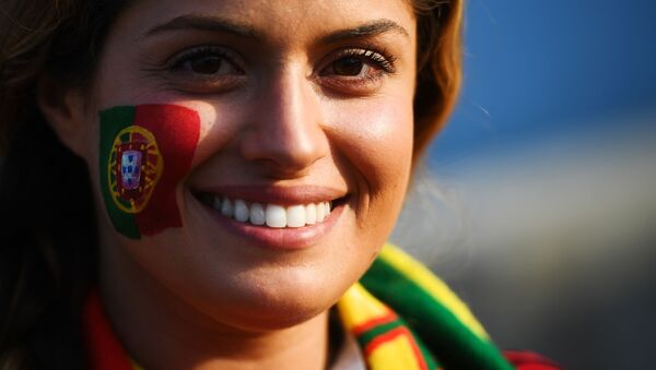 A fan of the Portugal national team before the start of a group stage match between Portugal and Spain. - Sputnik Mundo