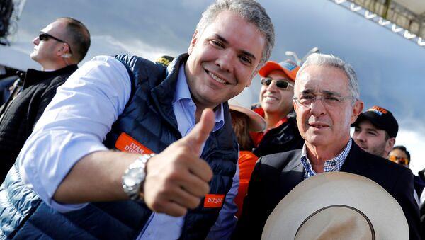 Presidente electo de Colombia Iván Duque y expresidente Álvaro Uribe - Sputnik Mundo