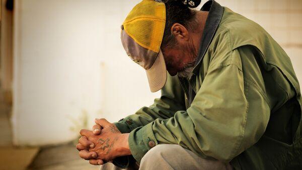 Una persona pobre (imagen referencial) - Sputnik Mundo