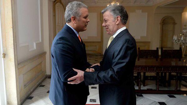 El presidente de Colombia, Juan Manuel Santos, junto al presidente electo, Iván Duque - Sputnik Mundo