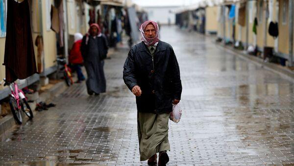 Un refugiado sirio - Sputnik Mundo