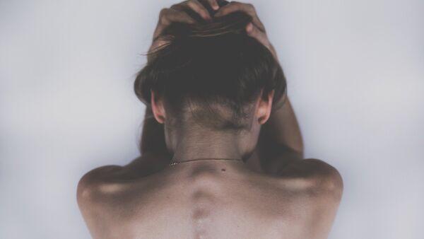 Una mujer de espaldas (imagen referencial) - Sputnik Mundo