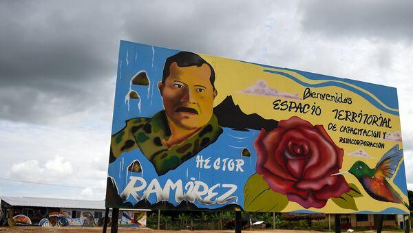 Un cartel en el Espacio Territorial de Capacitación y Reincorporación en Caquetá, Colombia - Sputnik Mundo
