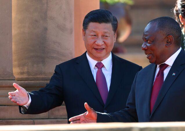 El presidente chino, Xi Jinping, con a su homólogo sudafricano, Cyril Ramaphosa