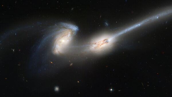 Fusión de galaxias (imágen referencial) - Sputnik Mundo