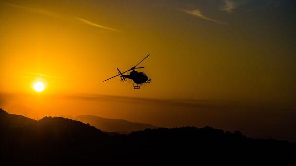 Un helicóptero (imagen referencial) - Sputnik Mundo