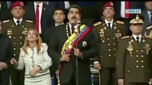 Momento de la explosión que interrumpió el discurso de Nicolás Maduro - Sputnik Mundo