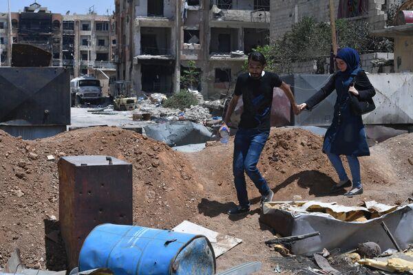 Durante los combates en Siria fueron destruidas numerosas ciudades y edificios de valor histórico. En la foto: el antiguo campo de refugiados palestinos Yarmuk, al sur de la ciudad de Damasco, mayo de 2018. - Sputnik Mundo