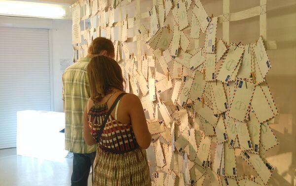 Visitantes de la exposición - Sputnik Mundo