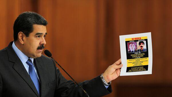El presidente venezolano, Nicolás Maduro, muestra las pruebas del atentado en su contra - Sputnik Mundo