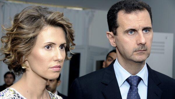 Asma Asad, primera dama siria, al lado de su marido, el presidente Bashar Asad - Sputnik Mundo
