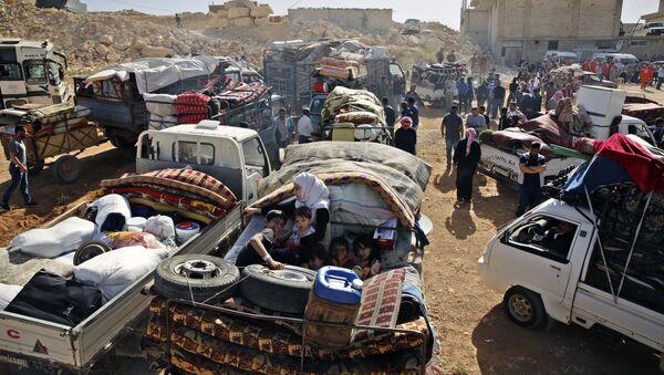Una caravana de refugiados sirios - Sputnik Mundo