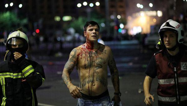Un manifestante rumano - Sputnik Mundo