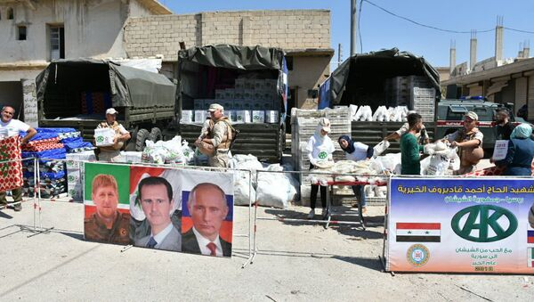 Punto de entrega de ayuda humanitaria de la Fundación Pública Local Ajmat Kadírov en Alepo - Sputnik Mundo