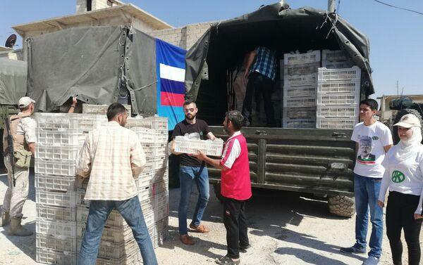 Descarga de la ayuda humanitaria enviada por la Fundación Pública Ajmat Kadírov - Sputnik Mundo