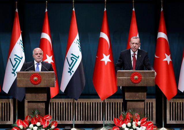 Heidar al Abadi, primer ministro iraquí y Recep Tayyip Erdogan, presidente turco