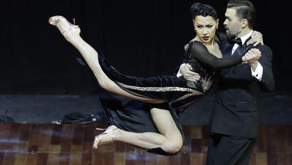 Российска пара Дмитрий Васин и Согдиана Хамзина во время выступления на Чемпионате мира по танго в Аргентине  - Sputnik Mundo