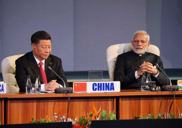El primer ministro indio, Narendra Modi, y el presidente chino, Xi Jinping