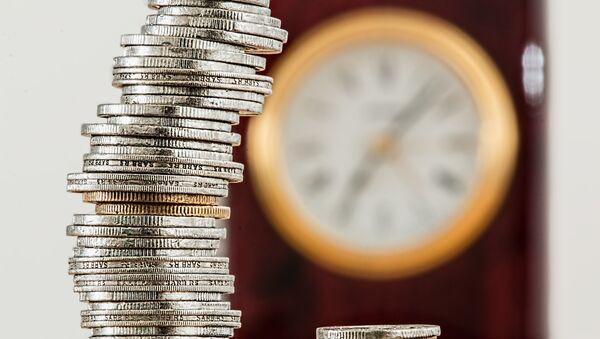Monedas y un reloj - Sputnik Mundo