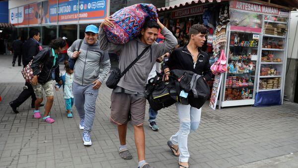 Los migrantes venezolanos en Perú - Sputnik Mundo