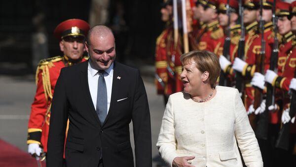 La visita de Angela Merkel a Georgia - Sputnik Mundo