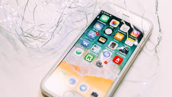 Un iPhone, imagen referencial - Sputnik Mundo