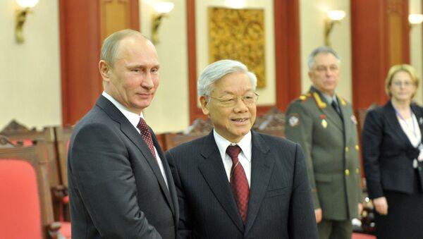 Presidente de Rusia, Vladímir Putin, y secretario general de Comité Central del Partido Comunista de Vietnam, Nguyen Phu Trong (Archivo) - Sputnik Mundo