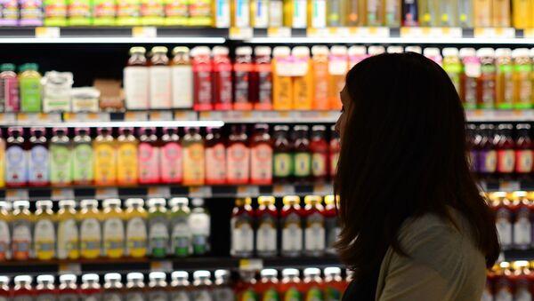 Mujer en un supermercado - Sputnik Mundo