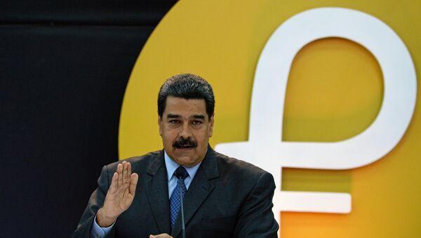 Nicolás Maduro presenta el petro - Sputnik Mundo