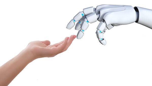 Humano le da la mano a un robot - Sputnik Mundo