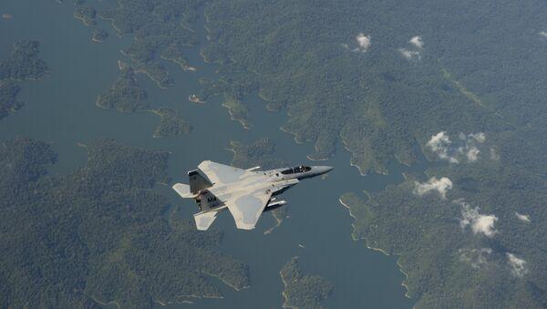 Un F-15 estadounidense - Sputnik Mundo