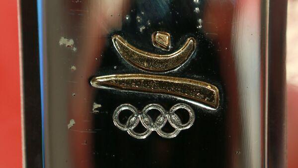 Un símbolo de JJOO de 1992 en Barcelona en la antorcha olímpica (achivo) - Sputnik Mundo
