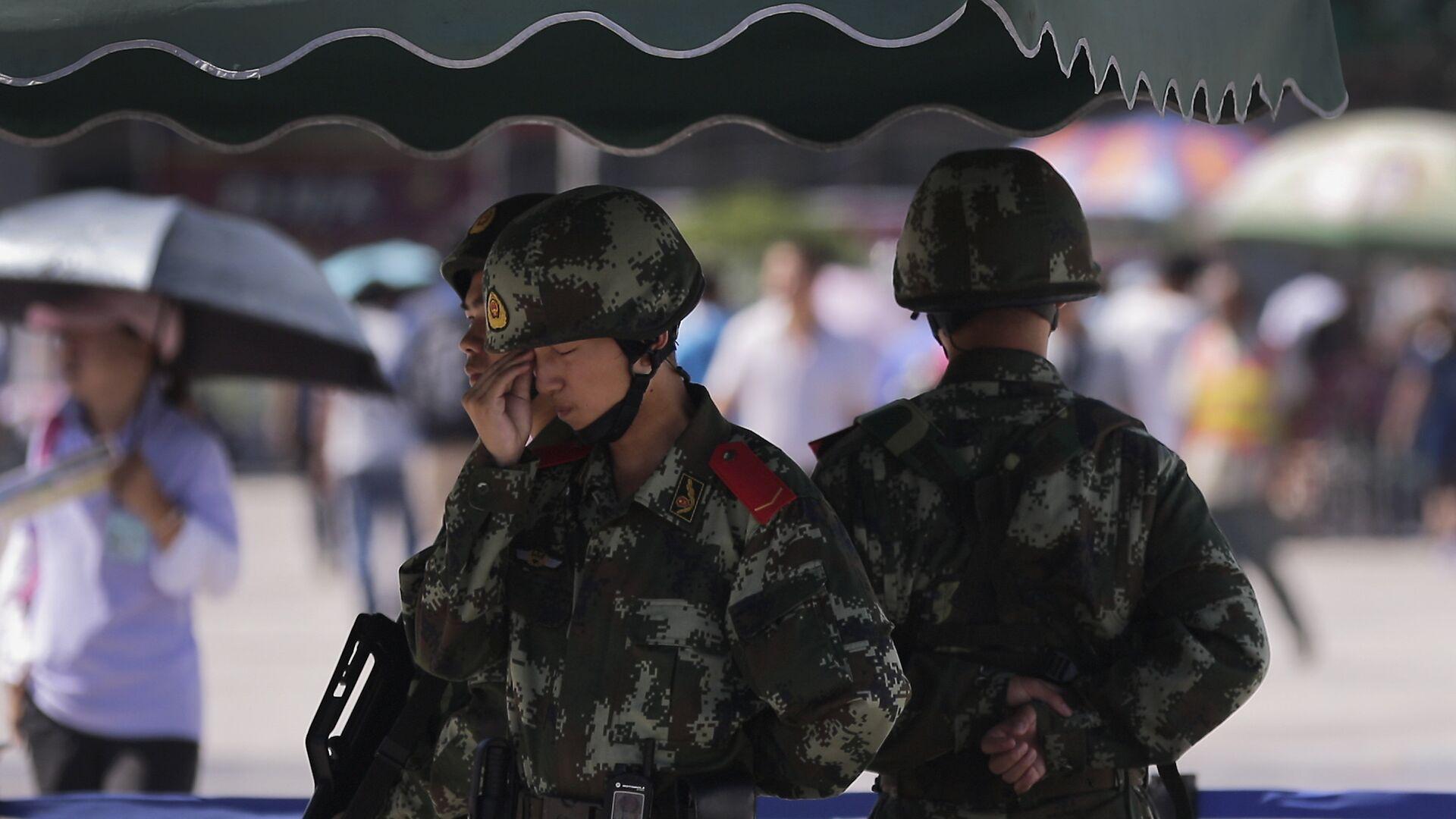 La policía militar china en la región autónoma Uigur de Xinjiang (archivo) - Sputnik Mundo, 1920, 01.07.2021